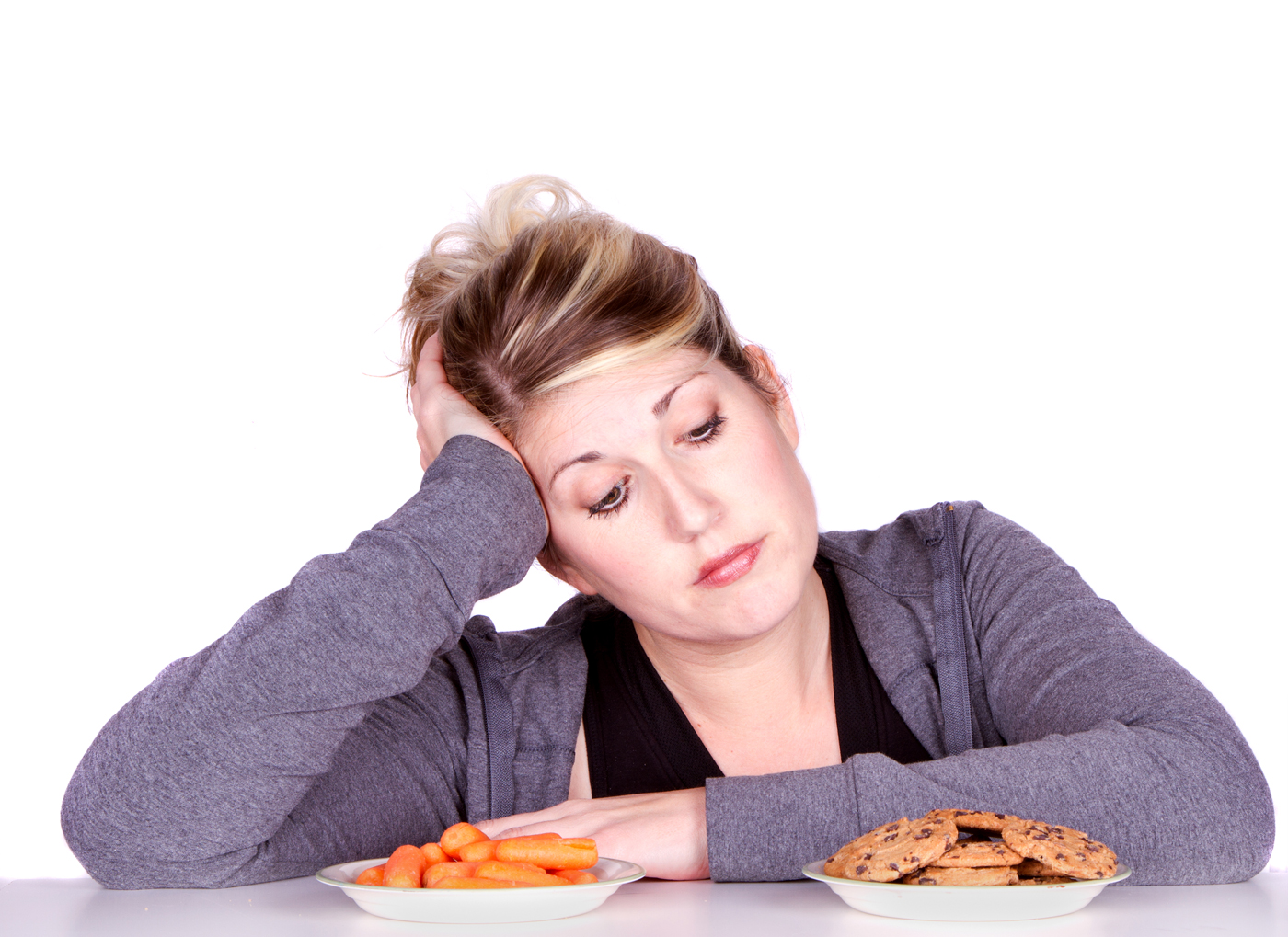 woman chooses between cookies and carrots